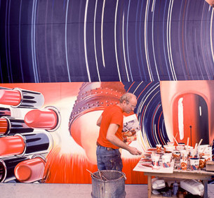 "BOB ADELMAN (1930-2016)  James Rosenquist in his studio, working on the painting, ""Fahrenheit 1982"", currently in the collection of MOMA  photograph 1981 (printed later)  archival pigment print, AP, signed  paper size > 30 x 20.5 inches"