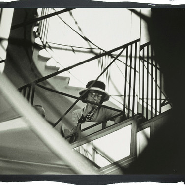 Douglas Kirkland  Mlle Chanel on the mirrored staircase of the House of Chanel  photograph 1962 [printed later]  platinum / palladium print, edition of 12, signed and numbered  paper size 16 x 20 inches