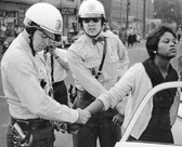 BOB ADELMAN (1931-2016) Innocent bystander arrested, Birmingham, Alabama photo 1963 [printed later]  gelatin silver print, edition of 15, signed, numbered  paper size > 16 x 20 inches