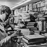"""Photograph by Hatami (1928-2017) Mia Farrow in the Strand book store scene, New York City, on the set of """"Rosemary's Baby"""" photograph 196 vintage gelatin silver print, signed, stamped 7.75 x 10.75 inches"""