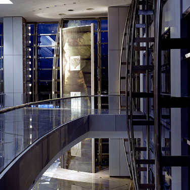 """WARREN CARTHER  Approach of Time from """"The Chronos Trilogy""""  dichroic glass,  40 ft high  Lincoln House, Hong Kong"""