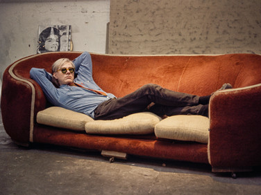 Bob Adelman (1930-2016) Andy Warhol on the red Factory couch (which was used in the 1964 film 'Couch'). Silk-screened 'Jackie' in the background  photograph 1965 (printed later) archival pigment print paper size > 13 x 19 inches