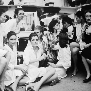 Coco Chanel with models, House of Chanel, Paris  photograph circa 1965 (printed later)  archival pigment print, AP, signed  image size > 11 x 15.5 inches  Photograph by Hatami (1928-2017)