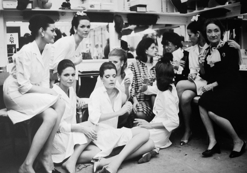 Coco Chanel with Models, House of Chanel, rue Cambon, Paris Photograph circa 1965 (printed later) archival pigment print, AP, signed Image Size: 11 x 15.5 inches   27.9 x 39.4 cm  Photograph by Hatami (1928-2017)