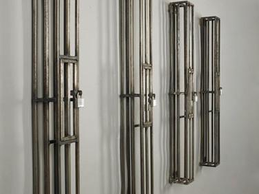 KAILI CHUN  Veritas, 2011  four steel cells  48 x 5 x 5 inches