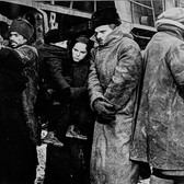 """Photograph by Hatami (1928-2017) Geraldine Chaplin and Omar Sharif in a scene where they are leaving Moscow for Varykino, on the set of """"Doctor Zhivago"""" photograph 1965  vintage gelatin silver print, signed, stamped  9 x 11.5 inches"""