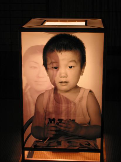 NOBUHO NAGASAWA Detail of See-Through Eyes (2003) wood, photographs, light ten lanterns; dimensions variable  Installation view from 2nd Echigo-Tsumari Art Triennial, Minamiabuzaka, Niigata, Japan, 2003.