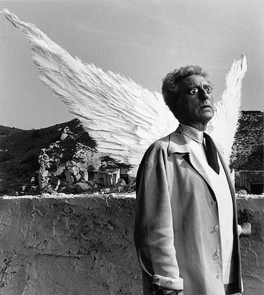 Lucien Clergue [1934-2014]  Jean Cocteau as The Poet and the Sphinx, Testament of Orpheus, Les Baux de Provence  photo 1959 [printed later]  gelatin silver print, edition of 30 PF, signed  Paper Size: 15.5 x 11.5 inches   39.4 x 29.2 cm Image Size: 13.75 x 10.25 inches   34.9 x 26.0 cm