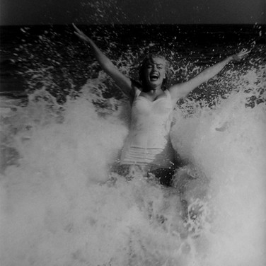 Sam Shaw [1912-1999]  Marilyn Monroe enjoying the beach in Easthampton, near her summer house in Amagansett, NY  photo 1957 [printed later]  gelatin silver print, AP, stamped by the Estate paper size > 19 x 15 inches
