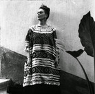 Leo Matiz (1917-1998)  Frida Kahlo on the steps of the Casa Azul with plant, Coyoacàn, Mexico  photo 1943 [printed 1997]  gelatin silver print, edition of 25, signed 17.25 x 13.25 inches