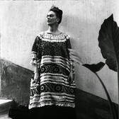 Leo Matiz (1917-1998) Frida Kahlo on the steps of the Casa Azul with plant, Coyoacàn, Mexico  photo 1943 [printed 1997 gelatin silver print, edition of 25, signed 17.25 x 13.25 inches