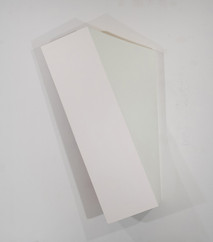 Tridimensional painting of a white rhomboid prism with a triangular side