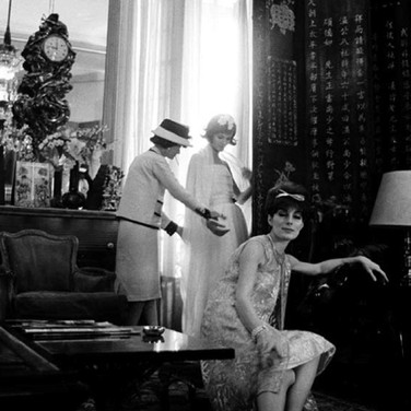 Douglas Kirkland  Mlle Chanel with models in her private apartment, House of Chanel. In the front, model Jackie Rogers  1962 [printed later]  archival pigment print, edition of 24, signed  paper size > 24 x 20 inches