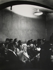 Marilyn Monroe sits in a crowd at the Actors Studio in New York City, 1956