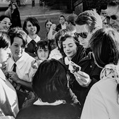 """Photograph by Hatami (1928-2017) Steve McQueen signing autographs, on the set of """"Bullitt"""" photograph 1968 vintage gelatin silver print, signed, stamped 9 x 12 inches"""
