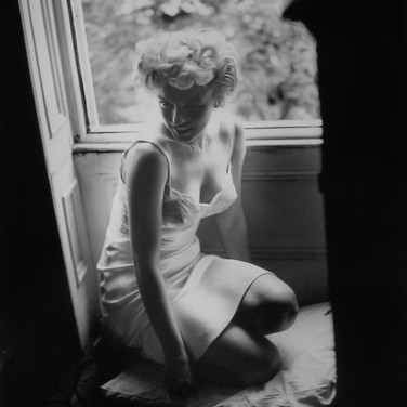 "SAM SHAW [1912-1999]  Marilyn Monroe on the New York set of ""The Seven Year Itch""  photo 1954 [printed later]  gelatin silver print, AP, stamped by the Estate paper size > 19 x 15 inches"