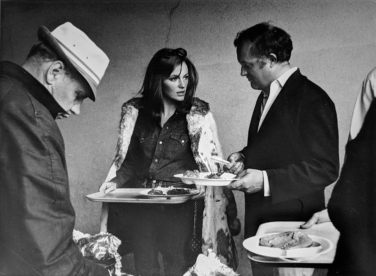 """Jacqueline Bisset and director Peter Yates during a lunch break, on the set of """"Bullitt,"""" 1968 vintage gelatin silver print, signed, stamped Image Size: 8.25 x 11.25 inches   21.0 x 28.6 cm  Photograph by Hatami (1928-2017)"""