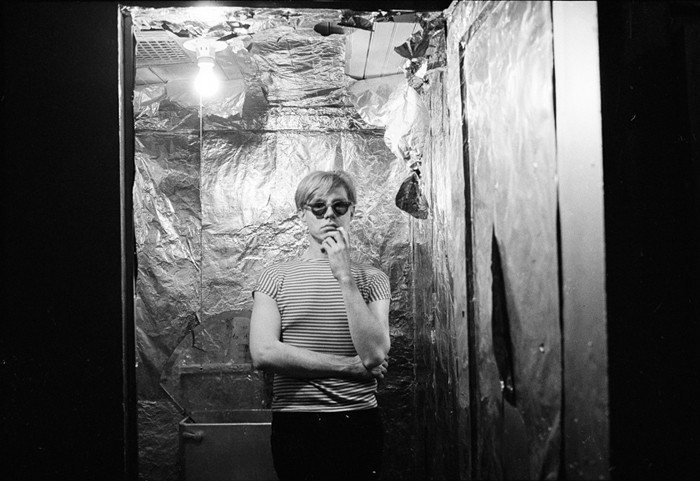 BOB ADELMAN (1930-2016) Andy Warhol in the silver-foil covered bathroom at the Factory photograph 1965 [printed later] archival pigment print, edition 1/20, signed Paper Size: 12.25 x 18.75 inches | 31.1 x 47.6 cm