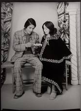 1960s black & white photograph of a couple in a photography studio