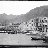 John Thomson (1837-1931)  The Waterfront, Hong Kong  photo 1869 [printed later]  gelatin silver print from the glass negative, edition of 350  16 x 20 inches, stamped
