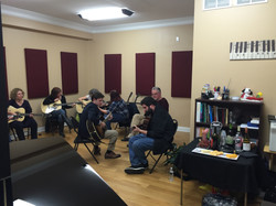 Our teacher Jim working on chords