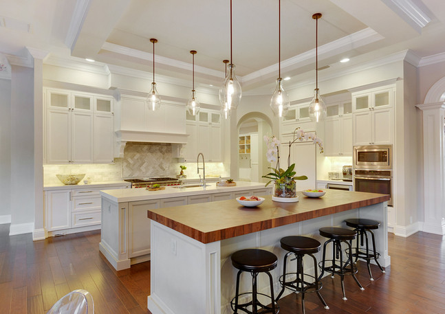Warm, transitional home overflowing with life interior design by HW Interiors