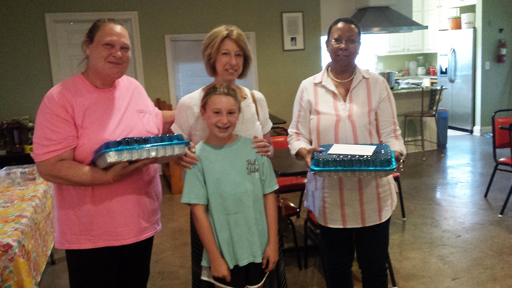 Celebrating August birthdays.  Cathy Halford and daughter of St. Columb's Episcopal Church-Ridgeland, MS (center) made Sonya and Linda's favorite cake!