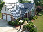 Martin Metal LLC in Versailles, Missouri-View homes and businesses with standing seam and snaploc metal roofing here.