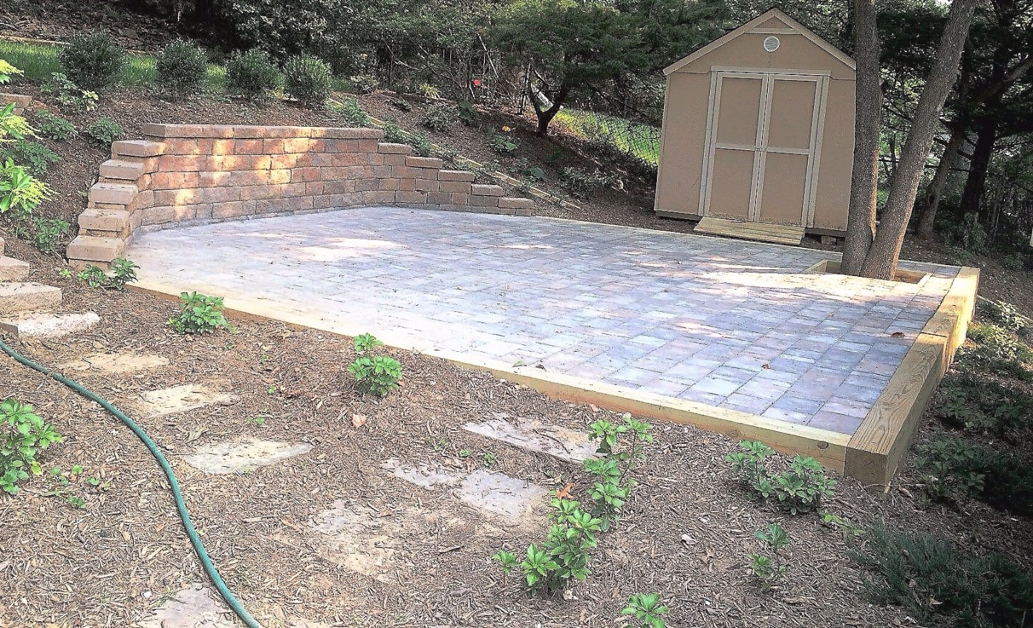 Stone wall and paver patio