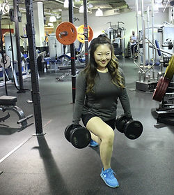 woman lifting weights inside a fitness centre
