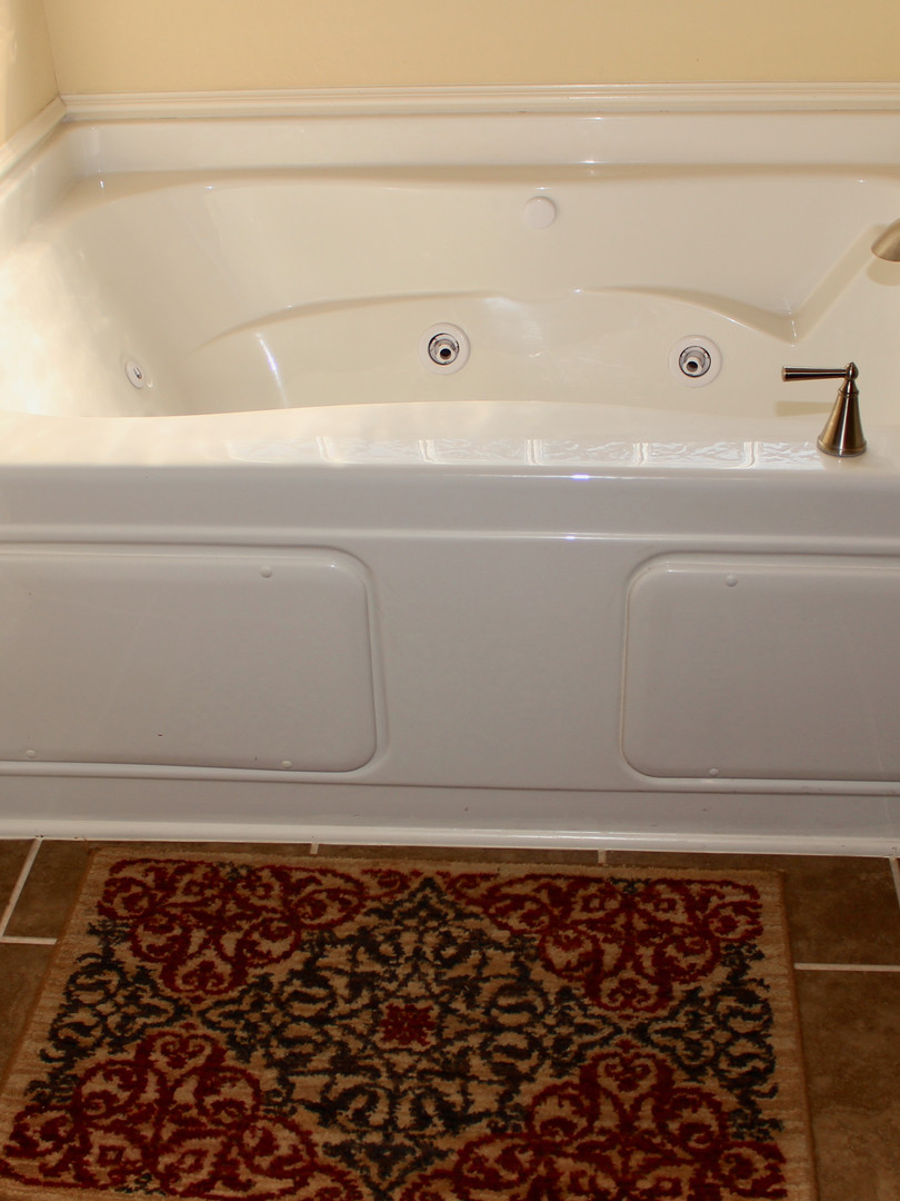 Jacuzzi tub next to seperate shower