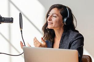 businesswoman-interviewed-for-a-podcast-2021-05-05-01-01-32-utc.jpg