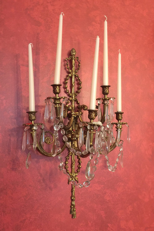 Exceptional pair of Neoclassical design gilt metal sconces.