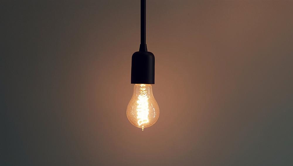 lightbulb hanging from ceiling