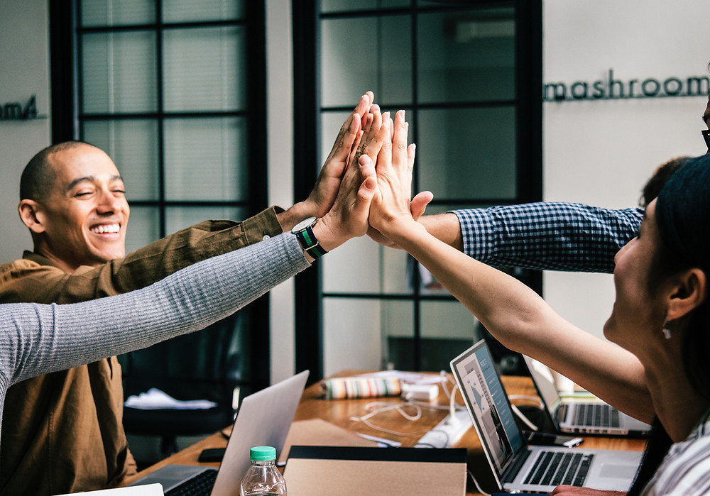 Group high-five in meeting