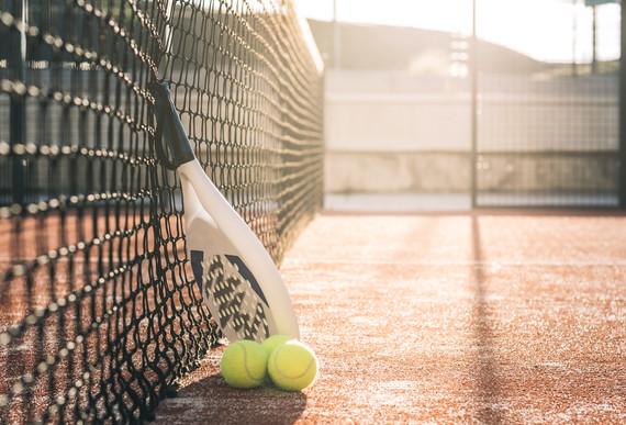 Padel blade racket resting on the net.jpg