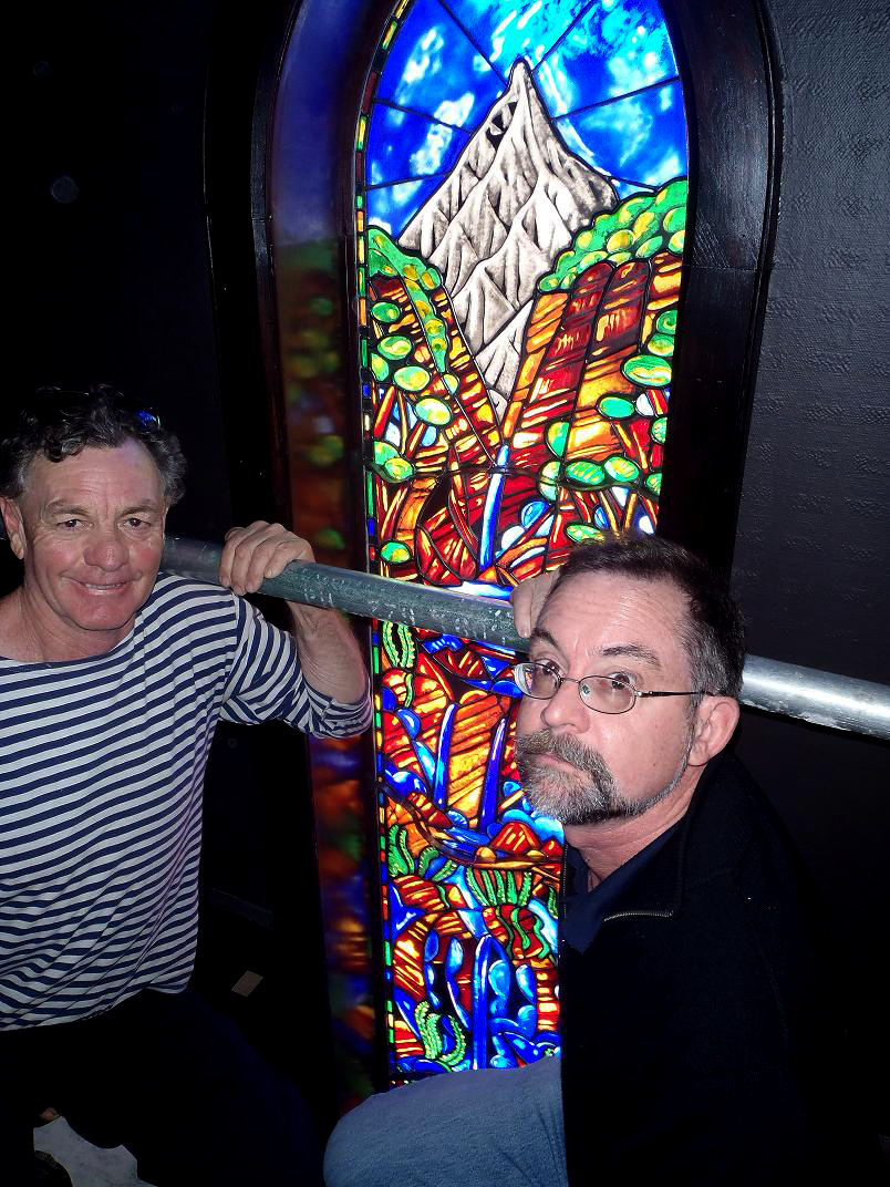 Dean Buchanan artist & Ray Salisbury stained glass window maker during installation of lancet window