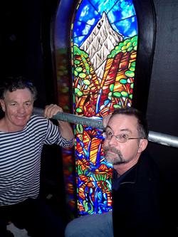 Dean Buchanan artist & Ray Salisbury stained glass window maker during installation of lancet window
