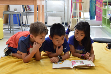 Reading three kids.JPG