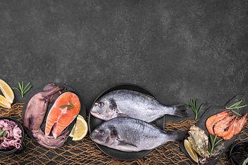 arrangement-various-types-fish-copy-space.jpg