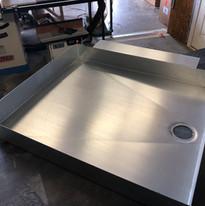 Custom fabricated shower base