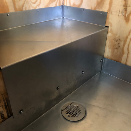 Metal shower base with step