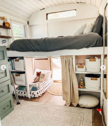 Sleeping area with queen bed and storage