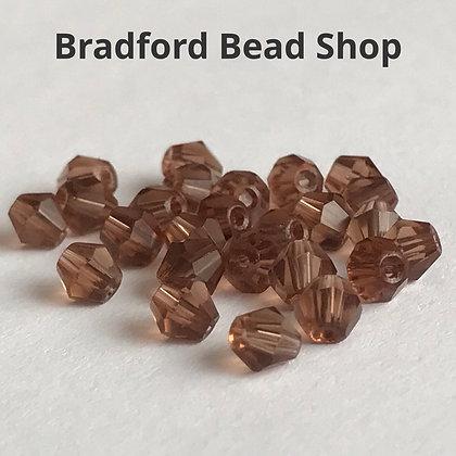 Machine Cut Bicone Beads - Deep Fawn Translucent - 4mm
