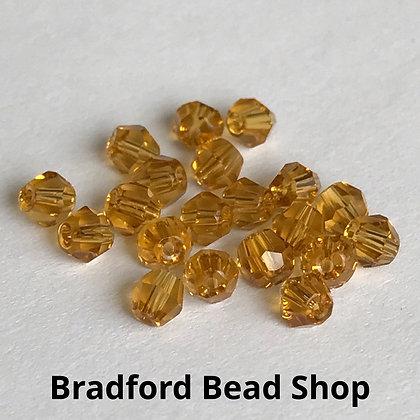 Machine Cut Bicone Beads - Sun Yellow Translucent - 4mm
