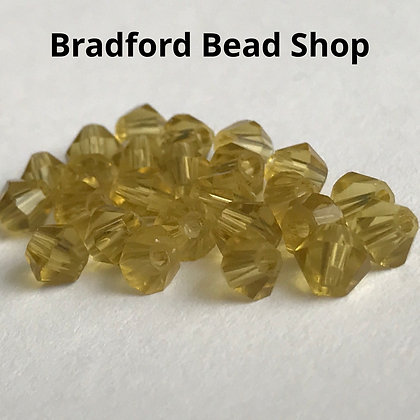 Machine Cut Bicone Beads - Leafy Yellow Translucent - 4mm