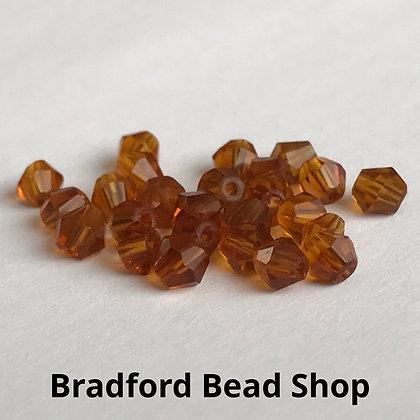 Machine Cut Bicone Beads - Topaz Translucent - app. 4mm