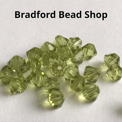 Machine Cut Bicone Beads - Light Green Translucent - 4mm