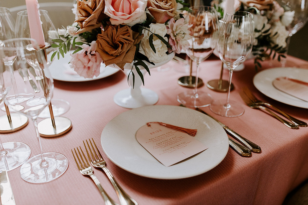 Blush pink wedding colour palette with pink wedding stationery, pink tassel and pink taper candles