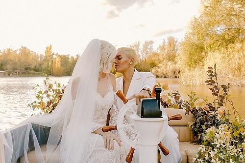 Wedding couple on a lake at Amber Lakes